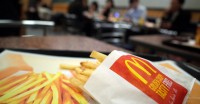 A small fries is seen at a McDonald's restaurant in Tokyo, Wednesday, Dec. 17, 2014. McDonald's began rationing its fries Wednesday morning. It said prolonged labor negotiations with port workers on the West Coast have made it difficult to meet demand despite an emergency airlift of 1,000 tons of spuds and an extra shipment from the U.S. East Coast by sea. (AP Photo/Eugene Hoshiko)