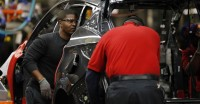 FILE - In this Nov. 5, 2014 file photo, Nissan trim and chassis workers work on a new 2015 Nissan Murano at the Nissan plant in Canton, Miss. The Labor Department releases the Producer Price Index for November on Friday, Dec. 12, 2014. (AP Photo/Rogelio V. Solis, File)