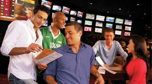 Group of men at the Race & Sports Book